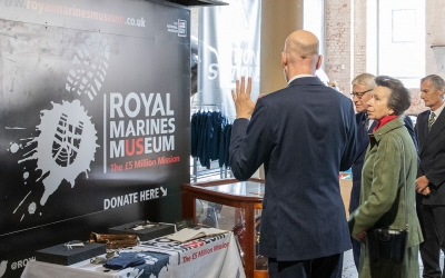 HRH The Princess Royal inspecting plans for the new Royal Marines Museum