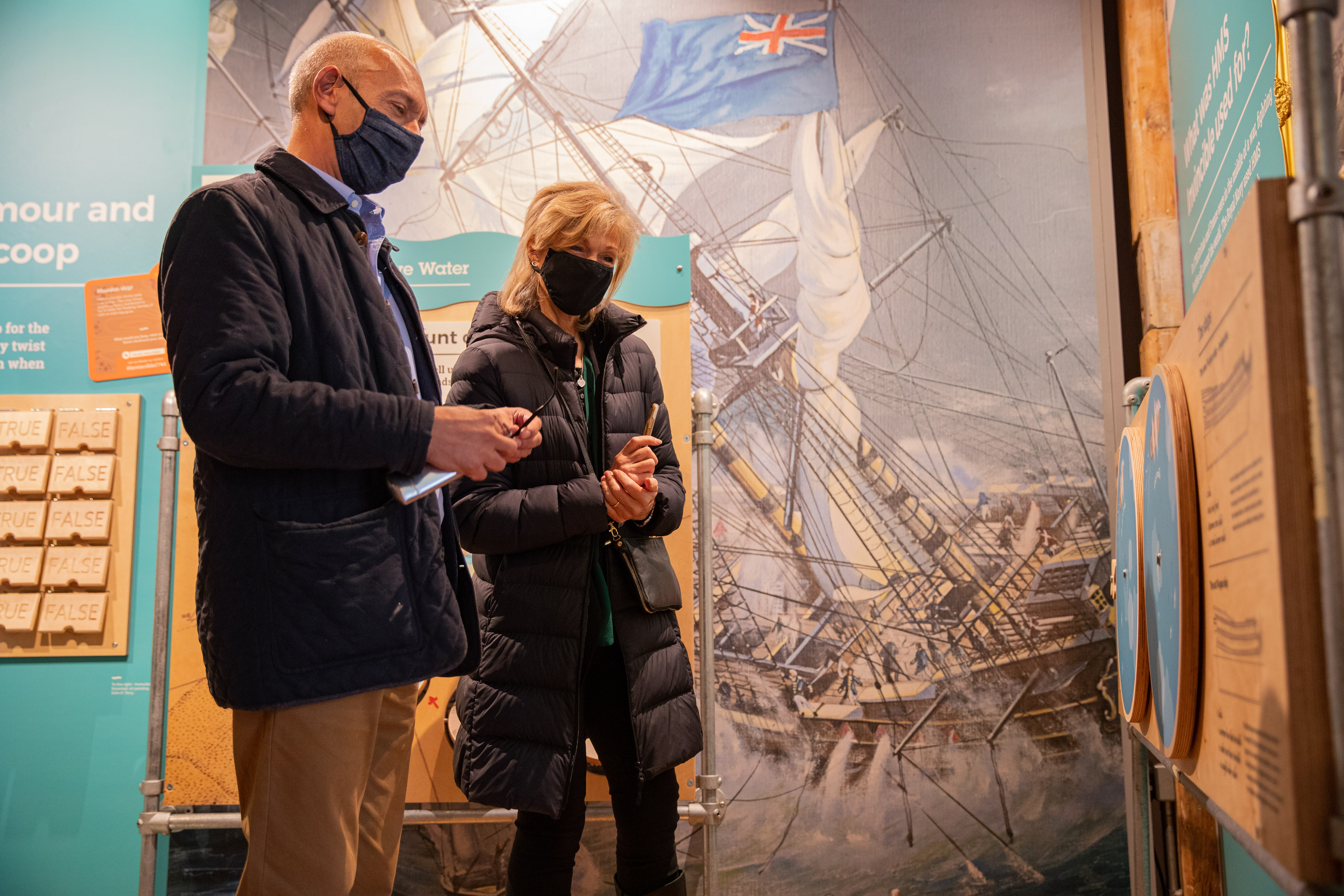 Visitors Reading a Display at Diving Deep Portsmouth Historic Dockyard Credit NMRN