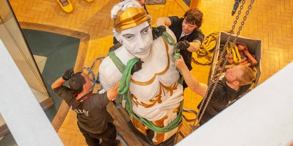 Centurion figurehead carefully lifted into place
